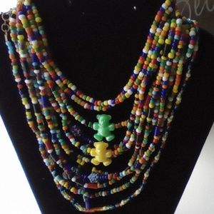 Lot of 9 Child Seed Bead Necklace & Charms.